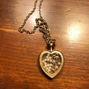 Gold necklace with heart pendant